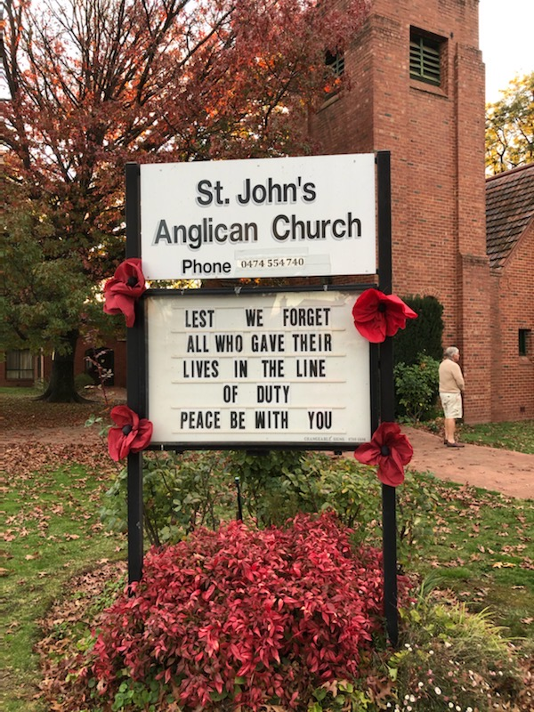 St John's information board with poppies